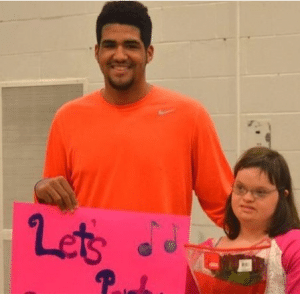 High school basketball star asks girl with Down syndrome to prom