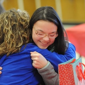 Sydney Stanley gets a hug from Alexis Jenkins after receiving a special Valentine's Day gift from Stanley. (Tom Russo | Daily Reporter) Thomas J Russo