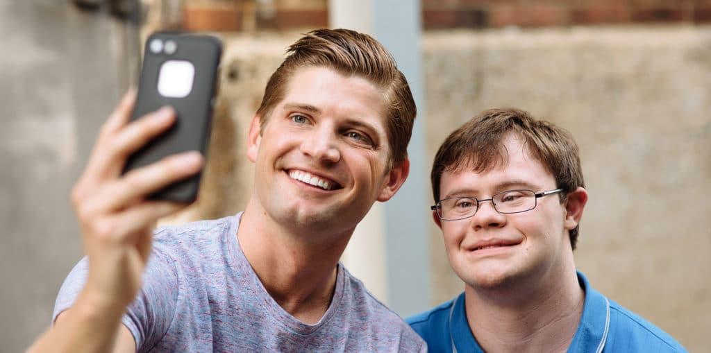 Best Buddies friendship pair taking a selfie
