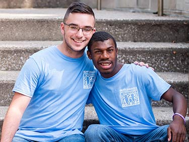 Man Holding a poster size check from Best Buddies Sponsor, Hublot in a crowded stadium