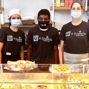 Best Buddies Jobs participant, Darrell (center), and co-workers at Best Buddies x Rosetta Bakery