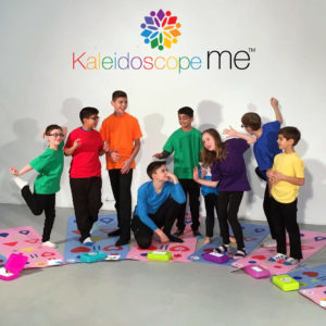 KaleidescopeMe activity with eight participants wearing bright colors smiling while playing