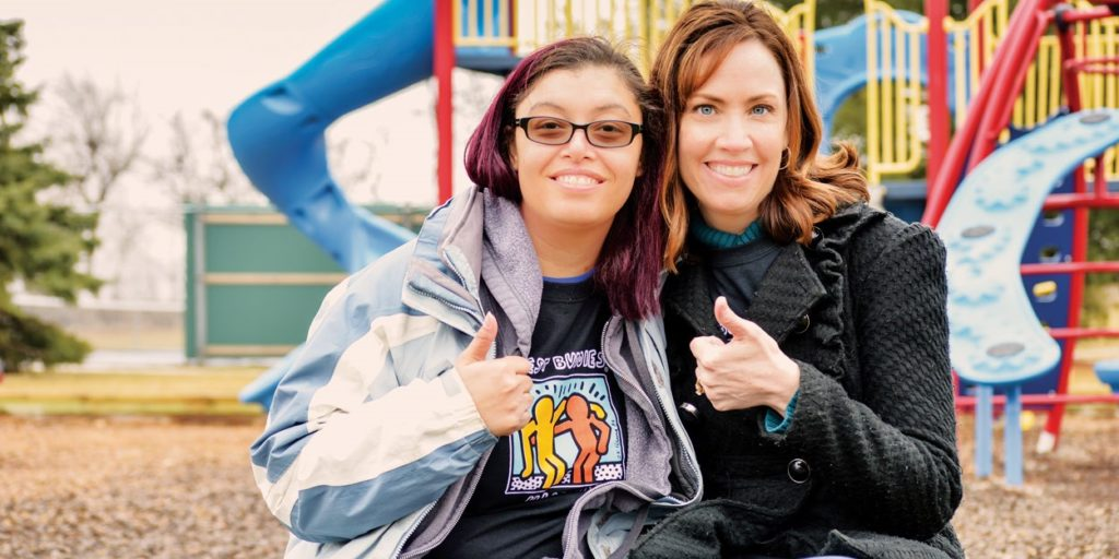 Best Buddies participants giving a thumbs up
