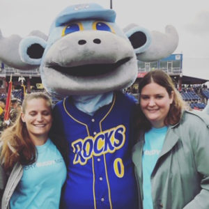 Best Buddies buddies Celeste and Vallerie posing with the Blue Rocks Mascot at Frawley Stadium