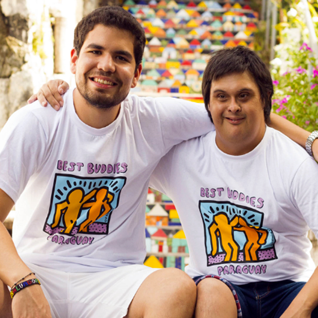 A pair of Best Buddies Paraguay Friendship Guy Participants embrace each other