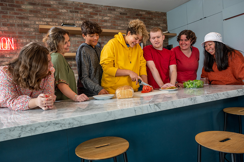 Group of Best Buddies Living Participants cooking together