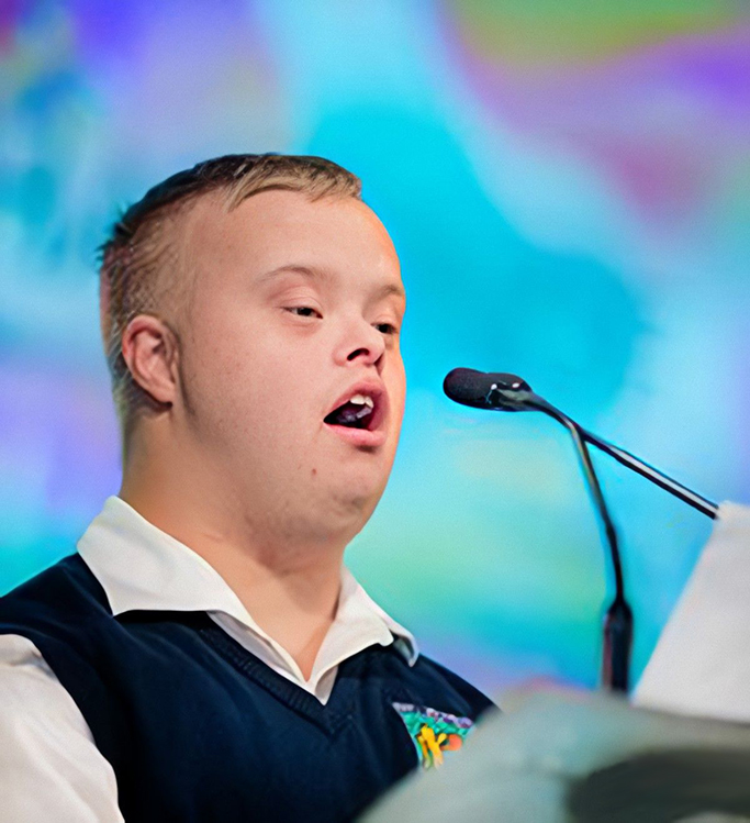 A Best Buddies Leadership participant speaks at a podium