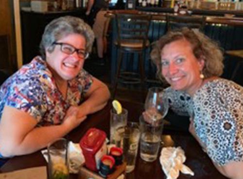 Liz and Christine having dinner together in a restaurant
