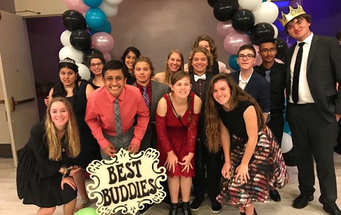 Best Buddies in California participant Maanav Kooner celebrating with members of his Best Buddies friends.