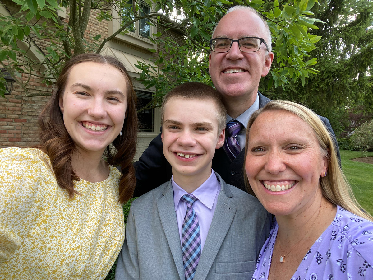 Best Buddies in Ohio parent Tina Charles-Beery smiling with husband and two children, Best Buddies chapter members Meghan and Aidan