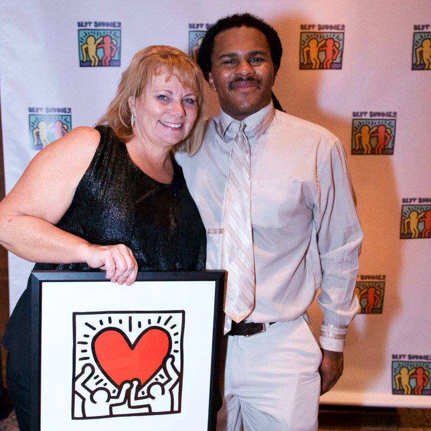 Best Buddies in Ohio participant Niles Dowe (right)