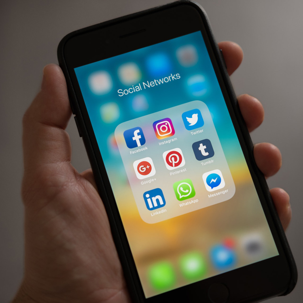 Nine Social Media icons shown on a phone's screen