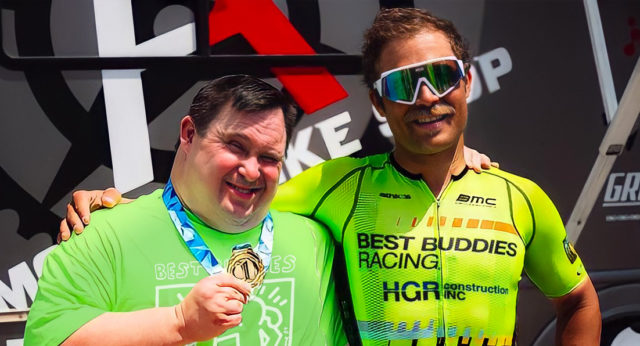 Eric Marcotte, right, after he and his Best Buddy, Michael Escardo, came off the podium.