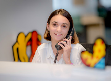 Female Best Buddies Jobs participant answering an office phone