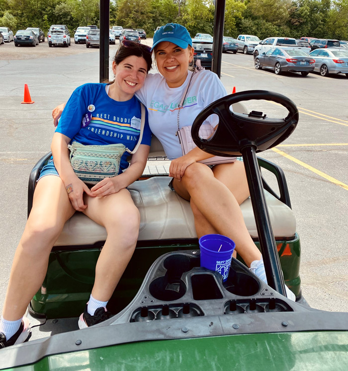 Citizen pair Chloe and Vanessa sitting in a golf cart