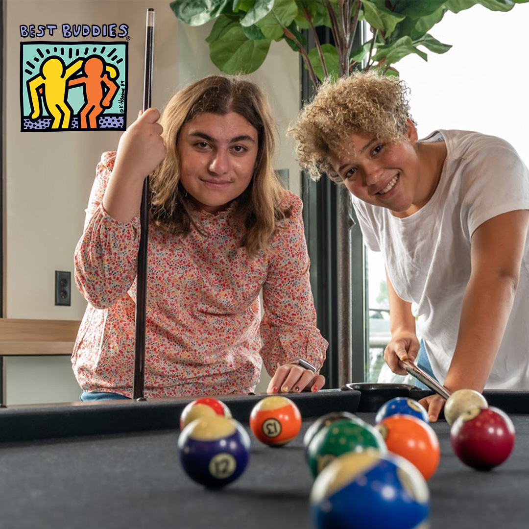 Best Buddies Living Participants Playing Pool