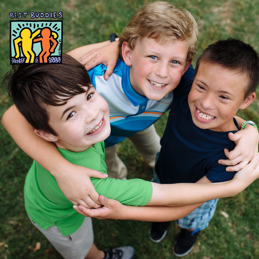 Young group of Best Buddies participants hugging